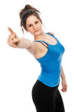 Pretty teenage girl pointing finger at camera. Stock Photography