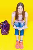 Pretty teenage girl preparation for exams and test. Education. Fashion student. Institute. Shopping. Bag. Color stock image