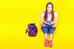 Pretty teenage girl preparation for exams and test. Education. Fashion student. Institute. Shopping. Bag. Color royalty free stock images