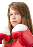 Pretty teenage girl with red boxing gloves Stock Photography