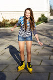 Pretty teenage girl rollerskating in park Royalty Free Stock Photography