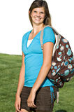 Pretty teenage girl with a school backpack. A pretty teenage girl wears a backpack on her way to school stock photos