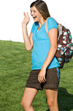 Pretty teenage girl with a school backpack. A pretty teenage girl wears a backpack on her way to school royalty free stock photography