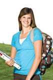 Pretty teenage girl with a school backpack. A pretty teenage girl wears a backpack on her way to school stock image