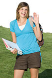 Pretty teenage girl with a school backpack. A pretty teenage girl wears a backpack on her way to school stock photography