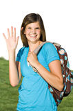 Pretty teenage girl with a school backpack. A pretty teenage girl wears a backpack on her way to school royalty free stock photo