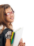 Pretty teenage girl with school bag and notebooks Stock Photos