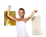 Pretty teenage girl with shopping bags Stock Photo
