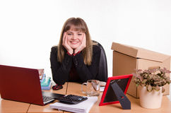 Pretty teenage girl sitting at office desk Royalty Free Stock Photography