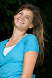 Pretty teenage girl smiling. A pretty teenage girl smiles at the camera royalty free stock images