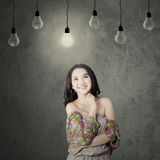 Pretty teenage girl standing under lamp Royalty Free Stock Photos