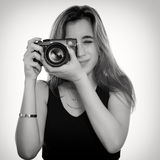 Pretty teenage girl taking pictures with a professional camera Stock Photos