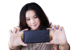 Pretty teenage girl taking a selfie Royalty Free Stock Photography