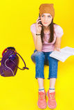 Pretty teenage girl uses a mobile phone. Fashion student. Shopping. Sms message. Calling. Bag. Color Stock Image