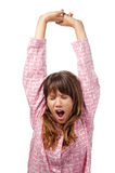 Pretty teenage girl yawning and waking up Royalty Free Stock Photo