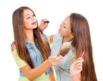 Pretty Teenage Girls. Applying Make up and Looking in the Mirror Royalty Free Stock Images