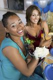Pretty teenage girls drinking at school dance Royalty Free Stock Image