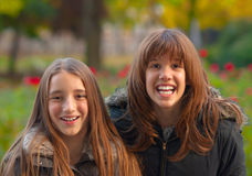 Pretty teenage girls having fun in the park. On beautiful autumn day Stock Photography