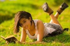 Pretty teenage hispanic girl wearing white top and Royalty Free Stock Image