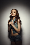 Pretty teenage model posing in denim suit Royalty Free Stock Images