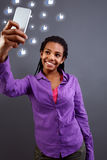 Teenage taking selfies with her smartphone royalty free stock images