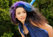 Pretty teenager. Pretty teenage girl ,smiling with blue and purple hair Stock Image