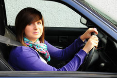Pretty teenager driving Royalty Free Stock Photos