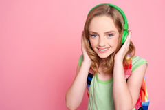 Pretty teenager enjoying music on headphones Stock Photography