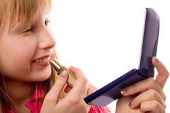 Pretty teenager girl applying make-up on  face Stock Photography