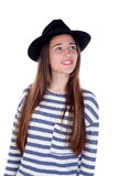 Pretty teenager girl with black hat posing at studio. Royalty Free Stock Images