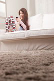 Pretty teenager girl checking her mobile phone. Pretty smiling teenager girl checking her mobile phone Royalty Free Stock Photo