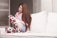 Pretty teenager girl checking her mobile phone Royalty Free Stock Photography