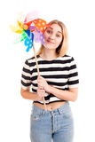 Pretty teenager girl with colour windmill isolated Stock Images