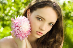 Pretty teenager girl with flower close-up royalty free stock image