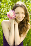 Pretty teenager girl with flower in garden Stock Photo