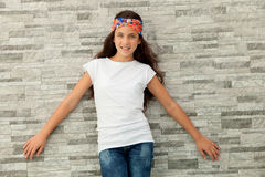 Pretty teenager girl with a flowered headband Stock Photography