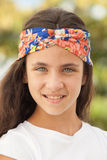 Pretty teenager girl with a flowered headband Stock Image