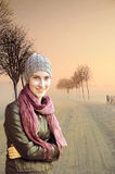 Pretty teenager girl. In foggy winter landscape stock images