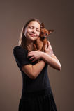 Pretty teenager girl with little doggy Royalty Free Stock Photos