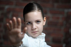 Pretty teenager girl making stop gesture. With her hand Stock Photos