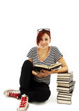 Pretty teenager girl sit on floor and reading book.  Stock Image