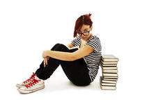 Pretty teenager girl sit on floor and reading book Royalty Free Stock Image