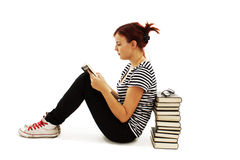 Pretty teenager girl sit on floor and reading book Stock Images