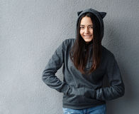 Pretty teenager girl smiling in  hoodie Stock Photography