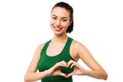 Pretty teenager making heart symbol with hands Royalty Free Stock Image