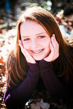 Pretty Teenager Radiant with Happiness. Happy and beautiful teenage girl with brown hair royalty free stock photography