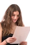 Pretty teenager reading the mail Royalty Free Stock Photo