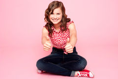 Pretty teenager showing double thumbs up. To camera Stock Images