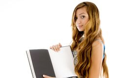 Pretty teenager showing notebook Royalty Free Stock Photography