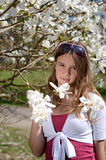 Pretty teenager in spring park Royalty Free Stock Images